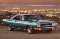 Plymouth... Trey loves this. Wants it in baby blue. Now thats a car!!!!