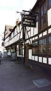 The Old Black Bear Inn, Tewkesbury - reputed to be the oldest Inn in Gloucestershire. The beer garden overlooks river Severn