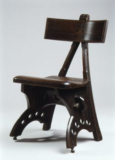 Side chair Designer: Edward Welby Pugin (British, London 1834–1875 London) Date: 1870 Culture: British Medium: Stained oak, ebony, brass Dimensions: 31-5/16 x 19-5/16 x 15-3/4 in. (79.5 x 49.1 x 40.0 cm) Classification: Woodwork-Furniture Credit Line: Purchase, Friends of European Sculpture and Decorative Arts Gifts, 1993