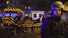 Rescuers workers evacuate a man on a stretcher near the Bataclan concert hall after a coordinated attack in Paris on November 13.
