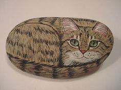Light-Brown-Tabby-Cat-hand-painted-on-a-stone-pet-rock-by-Ann-Kelly