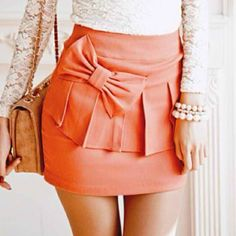 Coral/salmon, a bow, and a skirt paired with pearls... What more could I ask for.