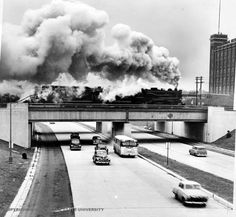 A steam engine passing over a highway in Detroit, 1950 .