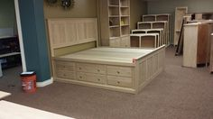 Solid Alder American made storage bed in so many combinations!  Twin Full Queen or King.  Deep drawers or standard drawer size.  Have the drawers on one side or both sides.  Choose a low pedestal or a higher pedestal as shown.  Unfinished, or with a beautiful Amish Finish.  Available at Wood Crafted Furniture Anchorage AK.