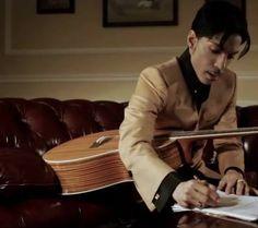 Prince writing down lyrics.