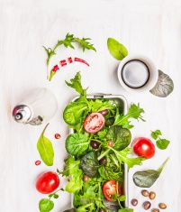 Green mix salad with tomatoes,oil and balsamic vinegar stock photo