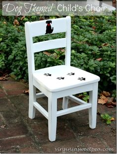 A painted dog and a seat covered with paw prints makes this child's chair charming.  virginiasweetpea.com