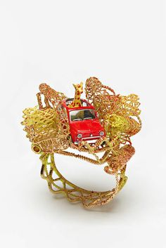 """2012"" bracelet, yellow giraffe, by Robert Baines"