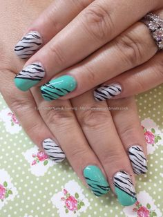 Mint green and grey gel with zebra nail art
