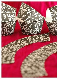 DIY cupcake wrappers... pretty for special occasions, and Lord knows I've got enough scrapbook paper to do it!