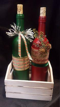 Christmas Bottles by WhimsicalWineDecor on Etsy Glass Bottle Crafts, Wine Bottle Art, Diy Bottle, Bottle Centerpieces, Christmas Centerpieces, Christmas Decorations, Christmas Wine Bottles, Lighted Wine Bottles, Holiday Crafts