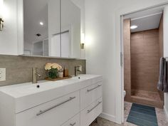 Newly remodeled bathroom with white cabinetry and tile floor 9202 Collingwood Drive, Austin, TX 78748