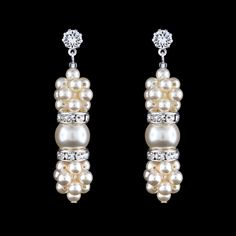 "Uniquely styled with woven clusters of pearl and crystal highlights, these handmade drops add a memorable accent to your wedding style. - 2"" long - Post back - Swarovski® pearls and crystals - Made in"