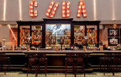 """Revolucion De Cuba - red letters with lights """"EAT"""""""