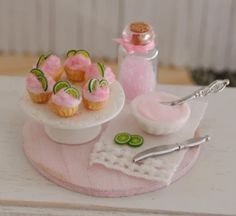 Miniature Pink Limeade Cupcakes Baking Board With A Bowl Of Pink Icing, A Jar Of Pink Sugar, Lime Slices, And A Vintage Towel. $28.50, via Etsy.