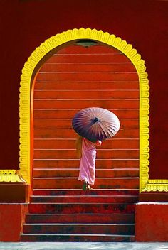 Yellow + Orange + Red Stairs + Arch + woman with parasol. Art Asiatique, Parasols, Under My Umbrella, Red Umbrella, We Are The World, Jolie Photo, World Of Color, Mellow Yellow, Windows