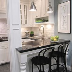 Condo kitchen: subway tiles plus legs on bar. Super-cute for a small space!