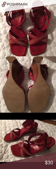 Red Sandal w/ beige stitching. Franco Sarto wedge heel. Suede instep. Leather ankle strap with some peeling in the inside ankle strap which is not noticeable from the outside. Never worn, tags have been removed. Franco Sarto Shoes Sandals