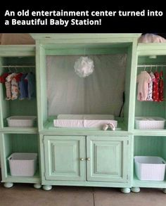 Old entertainment center turned baby changing station