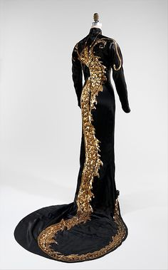 """While the dress may evoke the """"cheongsam"""", a from-fitting traditional Chinese dress style, its construction is along the lines of high-necked form-fitting Western gowns from the Belle-Epoque period, but the dragon motif adds a distinct Asian influence, dazzling in its execution in gold and silver sequins on luxurious satin."""