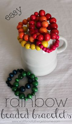 Make Easy Rainbow Beaded Bracelets with some stretchy cord and wooden beads via Wait Til Your Father Gets Home #bracelets #rainbow #jewelry ...