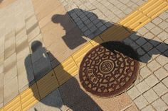 shadows over the manhole...