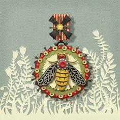 "Amazing ""Bee Medal"" paper cut by Elsa Mora."