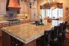 This kitchen island provides informal seating, wine storage & prep space. Home built by Martin Bros. Contracting.