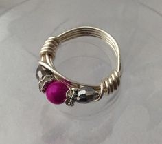 wire wrapped ring, glow pink and silver £9.50