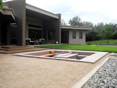The shape of the decks and fire pit is mirrored to the other side of the yard for the recessed hot tub.