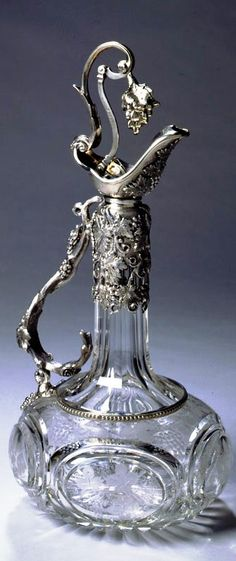 """From the Kent Collection A Victorian silver mounted claret jug by Henry Wilkinson, Sheffield, 1854. This jug has a patent registration mark for the pouring mechanism and is contained in its original red leather case. Ht. 13"""""""