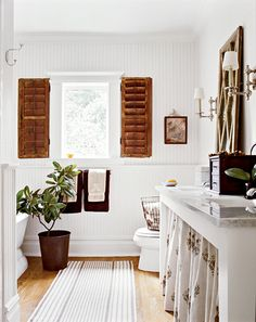 cottagey is not usually my style, but I love this bathroom, those shutters are great.