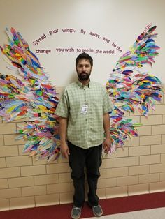Top 16 whole school collaborative projects for the new school year - feathered wings with each child decorating their own feather.