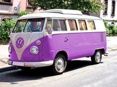 Purple VW Bus.... It's kind of adorable.... I bet this is what sesame street was transported in......