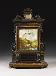 An ebonised fruitwood night timepiece, Italian, circa 1690 12in. x 10½in. dial painted with figures by a waterfall within a rural landscape, the upper section with an hour sector with quarter hour markings, the movement with circular plates, spring barrel and verge escapement, the case with swan-neck cresting and architectural surmount above side scrolls, the break-front base with a glazed panel, on bun feet