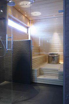 Sauna mit langem Fenster  Referenssit - Kodit - Sisustusarkkitehtitoimisto Saukkonen + Partners