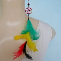 Brinco de penas coloridas, R$ 2,00