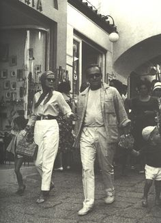 Grace Kelly with Prince Rainier III strolling the streets of Capri.