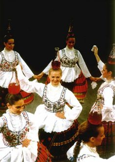 Hungarian folk dancers - balancing bottles with great skills