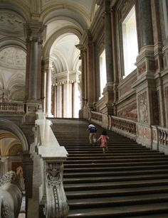 The monumental grand staircase at the royal  palace of caserta Naples Italy