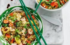Cauliflower rice is stir-fried with crunchy veggies, spices and prawns in this exciting midweek main. See more quick & healthy recipes at Tesco Real Food.