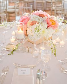 The softly shaded centerpieces included hydrangeas, orchids, peonies, plus a few on-theme seashells tucked in here and there.