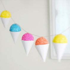 Snow Cone Garland: How appropriate… snow cones + pool parties = a recipe for fun! (via The Sweetest Occasion)