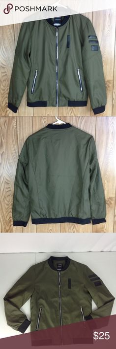 Green Jacket w/ Black Faux Leather Accents Size M This jacket is labeled as a men's fashion jacket but in my opinion best suits a woman. Material is in a foreign language. The zippers say Vogue. Armpit to armpit is 19 inches across Sleeve length is 23.5 inches Waist is 18 inches across Length is 24 inches Jackets & Coats