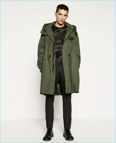 Anatol Modzelewski wears military greens, sporting an oversized parka and camouflage sweater from Zara Man.