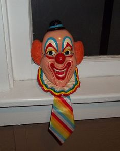 I'm so afraid of this thing  Vintage Taiwan Clown Face with Musical Pull Tie and Blinking Nose Wall Decor