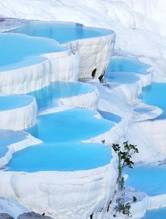 Natural Rock Pools, Pamukkale Hot Springs, Turkey. Pamukkale's terraces are made of travertine, a carbonate sedimentary rock deposited by water from the hot springs.