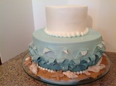 """Friend wanted a mermaid cake.  I came up with this Sea/Wave/Ocean cake. Mermaid was to be made by friend. Waves handcut of fondant, placed on buttercream, w/fondant pearls at base.  Gumpaste seashells and stars w/pearl accents and royal """"foam"""".  Brown sugar for sand."""