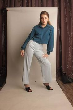 Teal shirt that will pair perfectly with denim jeans. Ever wonder how to dress up a pair of jeans, this is the perfect blouse for that. Teal Shirt, Denim Jeans, Button Up Shirts, Khaki Pants, Dress Up, Buttons, Blouse, Long Sleeve, Sleeves
