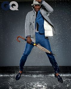 1399650580350_omar sy gq raincoat gq magazine may 2014 fashion style men weather 11